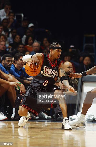 Allen Iverson of the Philadelphia 76ers drives the ball during the NBA game against the Washington Wizards at MCI Center on November 30 2002 in...