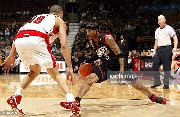 Allen Iverson of the Philadelphia 76ers drives the ball to the basket as Anthony Parker of the Toronto Raptors defends on November 8 2006 at the Air...