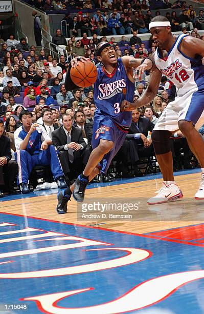 Allen Iverson of the Philadelphia 76ers drives the baseline against Elton Brand of the Los Angeles Clippers during the game at Staples Center on...