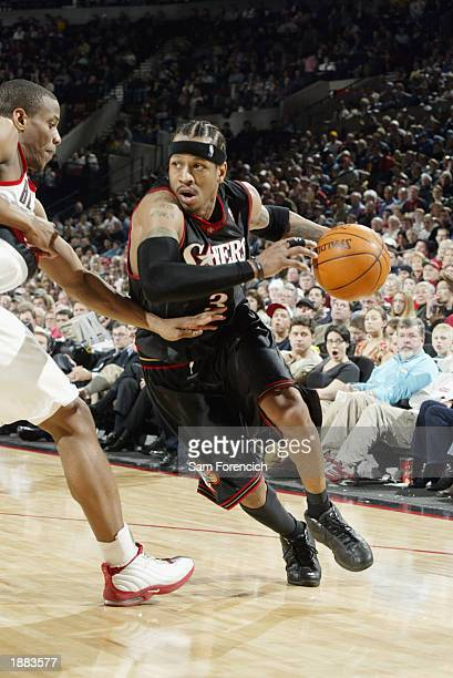 Allen Iverson of the Philadelphia 76ers drives the baseline around Antonio Daniels of the Portland Trail Blazers during the game at The Rose Garden...