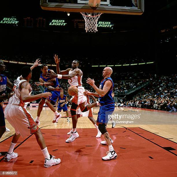 Allen Iverson of the Philadelphia 76ers drives through the lane and passes off against the Atlanta Hawks during a NBA game at the the Phillips Arena...