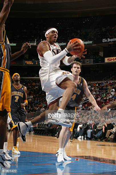 Allen Iverson of the Philadelphia 76ers drives through the lane against the Indiana Pacers on November 12 2004 at the Wachovia Center in Philadelphia...