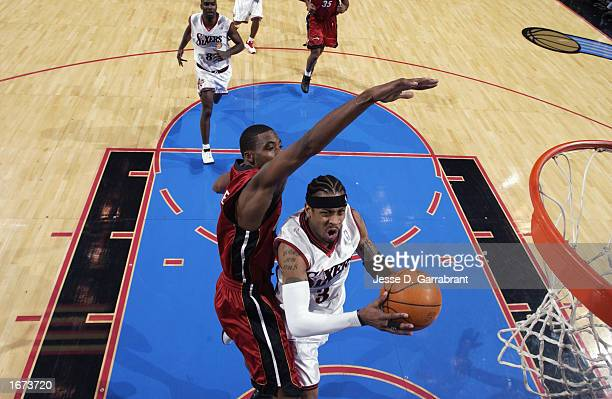 Allen Iverson of the Philadelphia 76ers drives to the basket against Eddie Jones of the Miami Heat during the NBA game at First Union Center on...