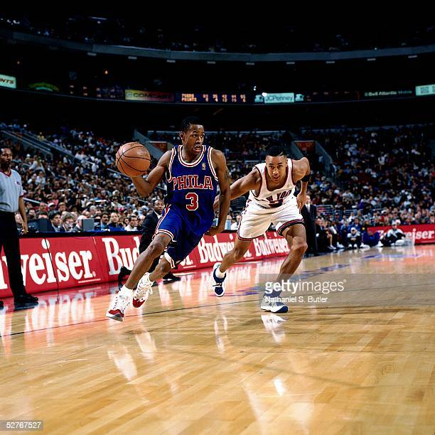 Allen Iverson of the Philadelphia 76ers drives to the basket against the New York Knicks during an NBA game at Madison Square Garden on November 23...