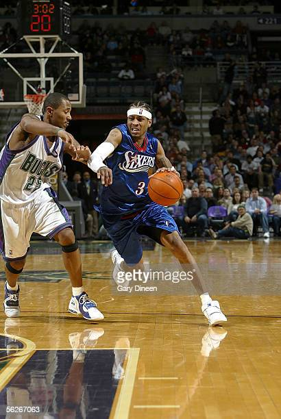 Allen Iverson of the Philadelphia 76ers drives to the basket against Maurice Williams of the Milwaukee Bucks on November 23 2005 at the Bradley...