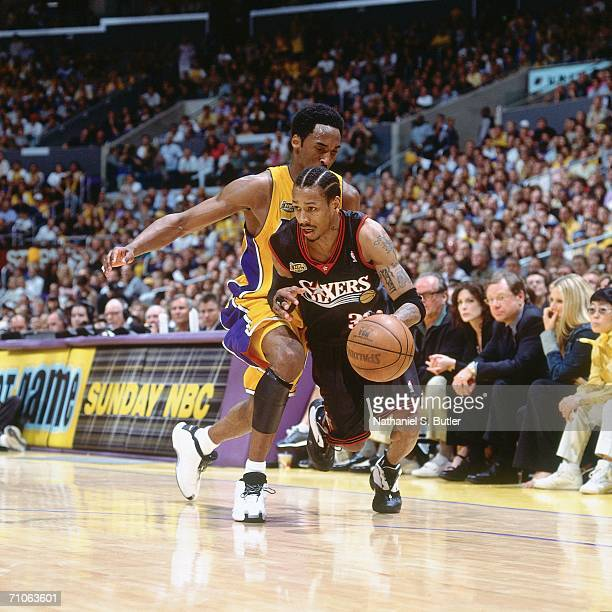 Allen Iverson of the Philadelphia 76ers drives to the basket against Kobe Bryant of the Los Angeles Lakers during game two of the 2001 NBA Finals...