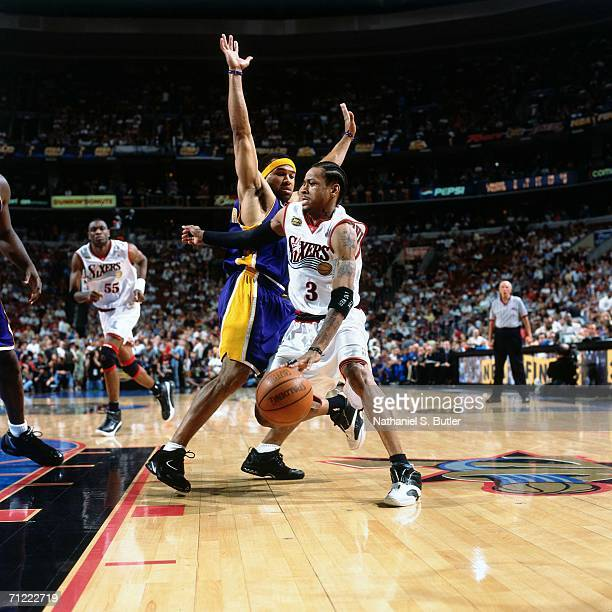 Allen Iverson of the Philadelphia 76ers drives to the basket against Derek Fisher of the Los Angeles Lakers during game five of the NBA FInals June...