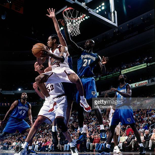 Allen Iverson of the Philadelphia 76ers drives to the basket against Kevin Garnett of the Phoenix Suns during a 2000 NBA Game played at the First...