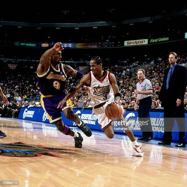 Allen Iverson of the Philadelphia 76ers drives to the basket against Kobe Bryant of the Los Angeles Lakers during a 2001 NBA game at the First Union...
