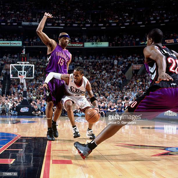 Allen Iverson of the Philadelphia 76ers drives to the basket against the Vince Carter of the Toronto Raptors during a 2001 NBA game at the First...