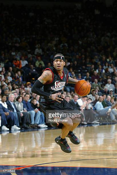 Allen Iverson of the Philadelphia 76ers drives to the basket during the NBA game against the Golden State Warriors at The Arena in Oakland on...