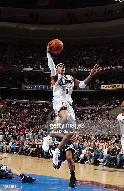 Allen Iverson of the Philadelphia 76ers drives to the basket during the game against the Orlando Magic at Wachovia Center on January 23 2004 in...