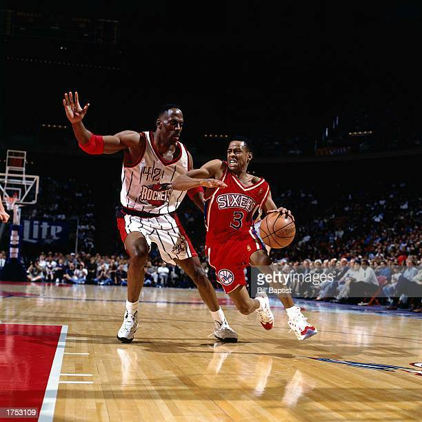 Allen Iverson of the Philadelphia 76ers drives to the basket for a reverse layup against Kevin Willis of the Houston Rockets at the Summit during the...