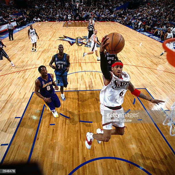 Allen Iverson of the Philadelphia 76ers drives to the basket for a layup during the 2002 NBA AllStar Game at the First Union Center on February 10...