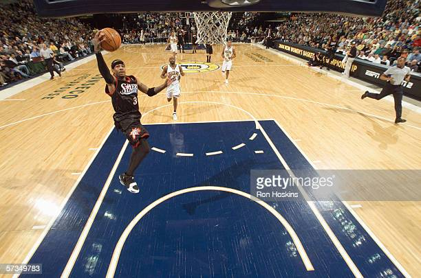 Allen Iverson of the Philadelphia 76ers drives to the basket for a layup during a game against the Indiana Pacers at Conseco Fieldhouse on March 26...