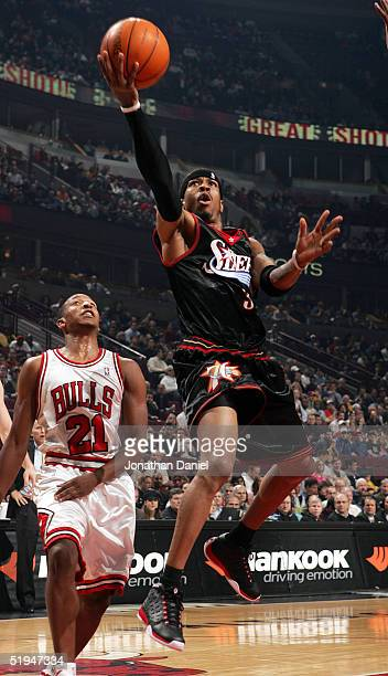 Allen Iverson of the Philadelphia 76ers drives to the basket past Chris Duhon of the Chicago Bulls on January 12 2005 at the United Center in Chicago...