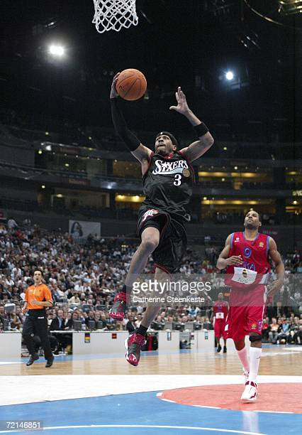 Allen Iverson of the Philadelphia 76ers drives to the basket past David Vanterpool of CSKA Moscow during a preseason game as part of the NBA Europe...