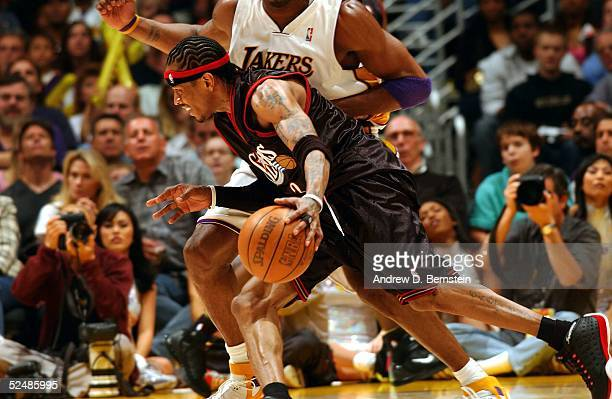 Allen Iverson of the Philadelphia 76ers drives to the hoop against Kobe Bryant of the Los Angeles Lakers March 27 2005 at the Staples Center in Los...