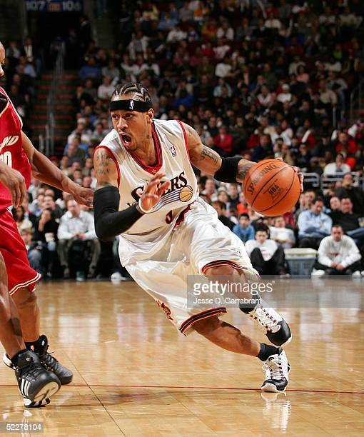 Allen Iverson of the Philadelphia 76ers drives to the net against Eric Snow of the Cleveland Cavaliers on March 4 2005 at the Wachovia Center in...