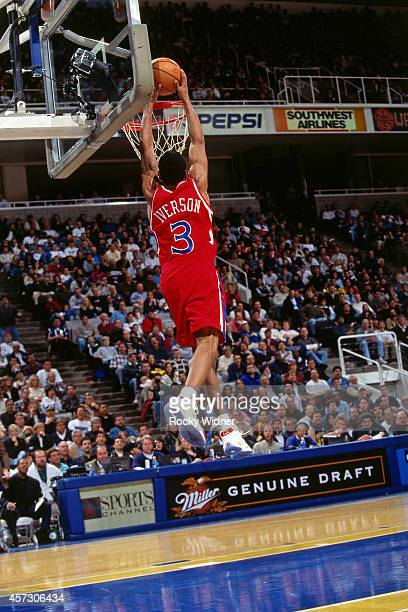Allen Iverson of the Philadelphia 76ers dunks against the Golden State Warriors on January 3 1997 at the Arena in Oakland in Oakland California NOTE...