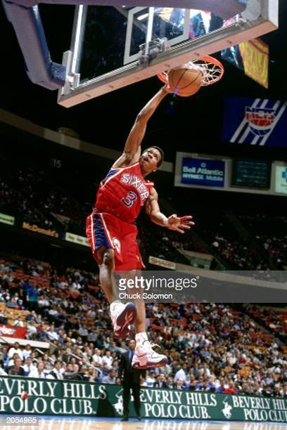 Allen Iverson of the Philadelphia 76ers dunks against the New Jersey Nets during a 1997 season NBA game at the Continental Airlines Arena in East...