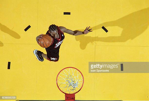 Allen Iverson of the Philadelphia 76ers dunks the ball during a National Basketball Association game against the Los Angeles Lakers at the Great...