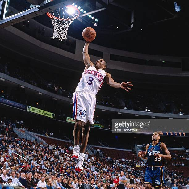Allen Iverson of the Philadelphia 76ers elevates for a dunk during a game against the Detroit Pistons in 1997 at the First Union Center in...
