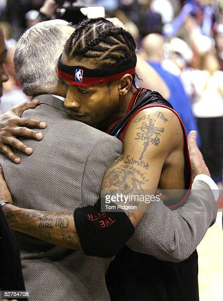 Allen Iverson of the Philadelphia 76ers embraces Larry Brown of the Detroit Pistons after Game five of the Eastern Conference Quarterfinals during...