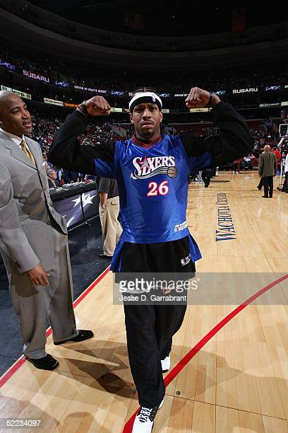 Allen Iverson of the Philadelphia 76ers flexes his biceps as he strikes a pose wearing a Kyle Korver jersey over his warmup attire before the game...