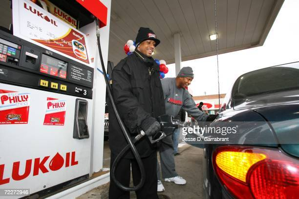 Allen Iverson of the Philadelphia 76ers gives away gas at a Lukoil gas station on October 26 2006 in Philadelphia Pennsylvania NOTE TO USER User...