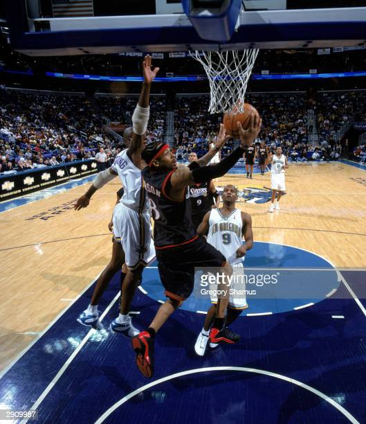 Allen Iverson of the Philadelphia 76ers goes for a layup during the NBA game against the New Orleans Hornets at New Orleans Arena on January 21 2004...