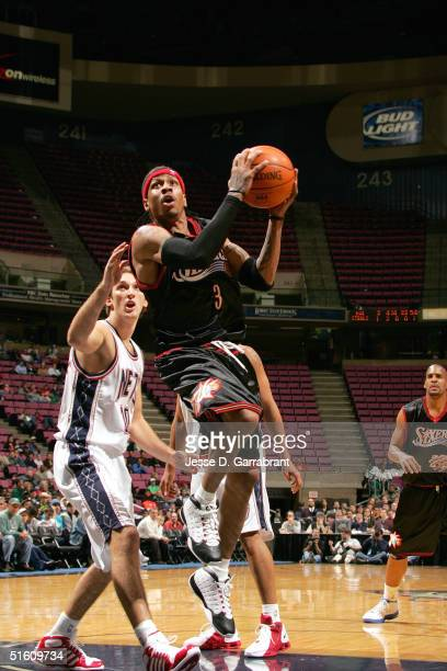 Allen Iverson of the Philadelphia 76ers goes for the layup against the New Jersey Nets on October 28 2004 at the Continental Airlines Arena in East...
