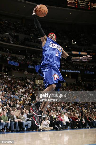 Allen Iverson of the Philadelphia 76ers goes to the basket against the Denver Nuggets on December 31 2004 at Pepsi Center in Denver Colorado NOTE TO...