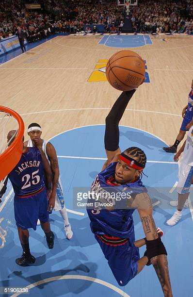 Allen Iverson of the Philadelphia 76ers goes to the basket against the Denver Nuggets December 31 2004 at Pepsi Center in Denver Colorado NOTE TO...