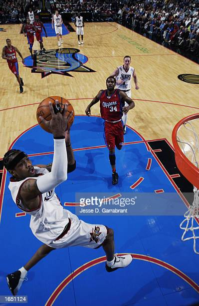 Allen Iverson of the Philadelphia 76ers goes to the net during the NBA game against the Los Angeles Clippers at First Union Center on November 6 2002...