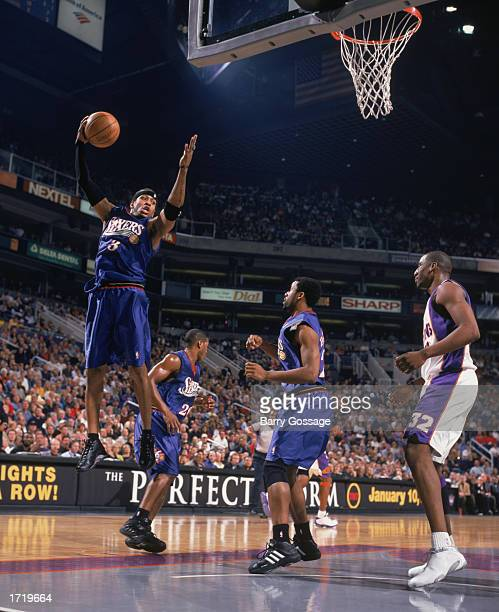 Allen Iverson of the Philadelphia 76ers goes up for the shot during the game against the Phoenix Suns at America West Arena on January 2 2003 in...