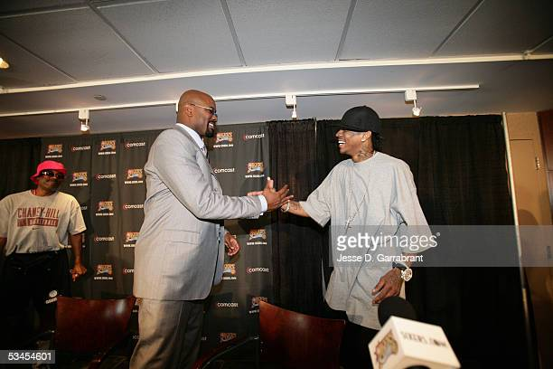 Allen Iverson of the Philadelphia 76ers greets team President and General Manager Billy Knight during a press conference to announce the signing of...