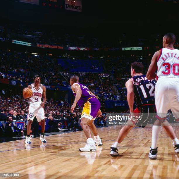 Allen Iverson of the Philadelphia 76ers handles the ball during the game during the 1997 NBA Rookie All-Star Game played on February 7, 1997 at Gund...