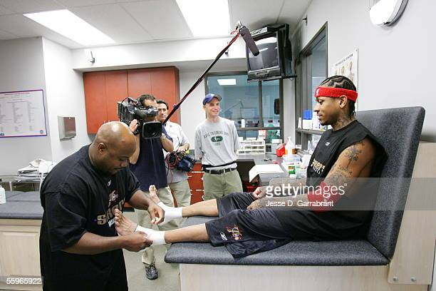 Allen Iverson of the Philadelphia 76ers has his ankles taped up during Real Training Camp on October 19 2005 at the Philadelphia College of...