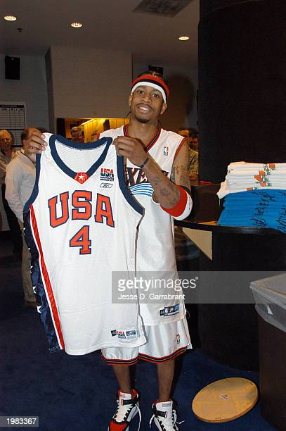 Allen Iverson of the Philadelphia 76ers holds up a USA Basketball Jersey in recognition of his selection to the 2003 USA Men's Senior National Team...