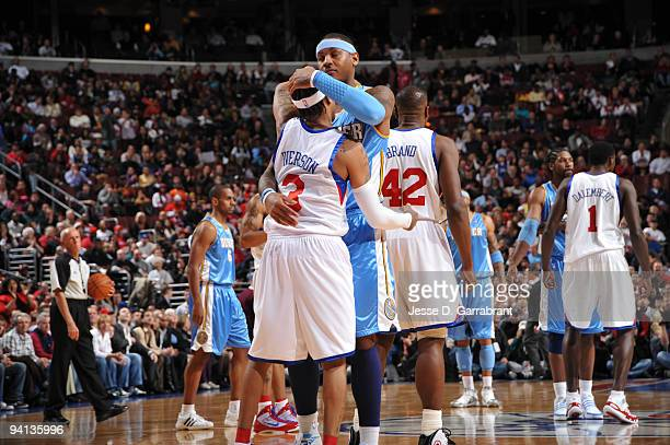 Allen Iverson of the Philadelphia 76ers hugs his old teammate Carmelo Anthony of the Denver Nuggets during the game on December 7 2009 at the...