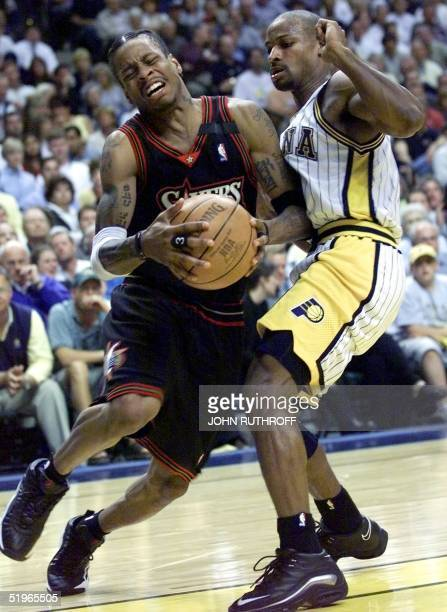 Allen Iverson of the Philadelphia 76ers is guarded by Travis Best of the Indiana Pacers 15 May during the first half of their Eastern Conference...