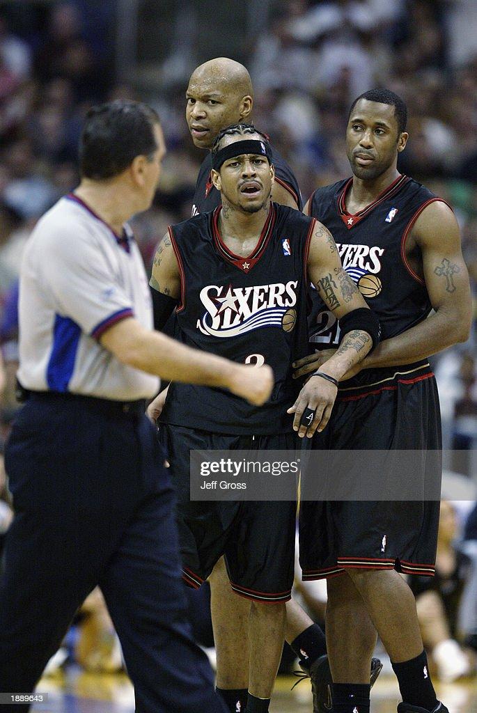 de9770688ea Allen Iverson of the Philadelphia 76ers is held back by teammates as ...