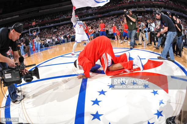 Allen Iverson of the Philadelphia 76ers kisses his new home court before the game against the Denver Nuggets on December 7 2009 at the Wachovia...