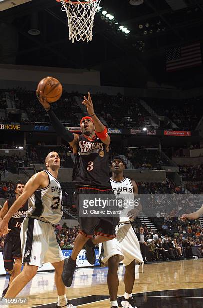 Allen Iverson of the Philadelphia 76ers lays a shot up during a preseason game against the San Antonio Spurs at SBC Center on October 25 2002 in San...