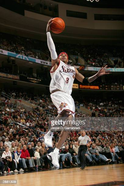 Allen Iverson of the Philadelphia 76ers lays one up past the defense of the Seattle Supersonics January 19 2004 at the Wachovia Center in...