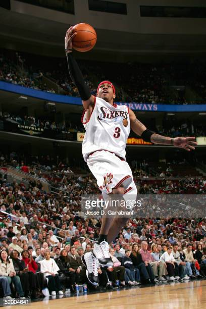 Allen Iverson of the Philadelphia 76ers lays one up past the defense of the New Orleans Hornets on January 17 2005 at the Wachovia Center in...