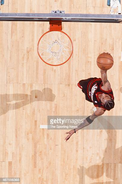 Allen Iverson of the Philadelphia 76ers lays up a shot during the game against the Charlotte Hornets on January 20 2000 at Charlotte Coliseum in...