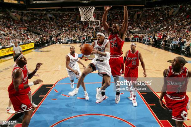 Allen Iverson of the Philadelphia 76ers looks for two against Antonio Davis of the Chicago Bulls on March 6 2004 at the Wachovia Center in...