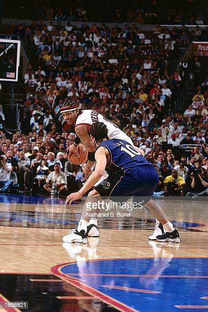 Allen Iverson of the Philadelphia 76ers looks to move against Tyronn Lue of the Washington Wizards during the NBA game at First Union Center on March...